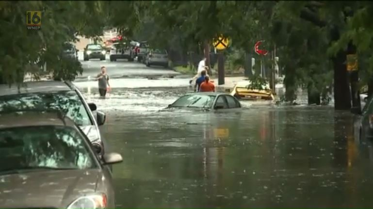 Flash Flooding Leaves Swamped Cars in its Wake