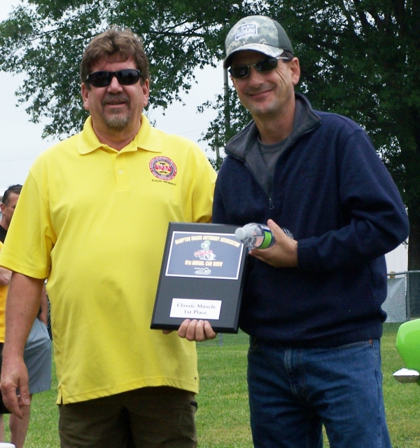 (Left) Steve Jellerson, President of Hampton Roads Autobody Association (HRAA), (Right) Bernard Chicoine, winner in the Classic Muscle Car category at the HRAA Car Show in Chesapeake, VA for his lime green 1967 Plymouth Barracuda .