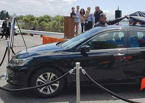 A Coast Guard family could barely speak in the face of the huge generosity shown as Mike's Auto Body Shop in Alameda, CA, unveiled their newly refurbished Honda.