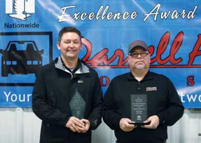 Co-owners Andy Emerson, left, and Steve Stallings received first-place awards for Showmanship of Excellence in North Carolina and nationally from Nationwide Insurance during a luncheon at Darrell Allen Body Shop on Feb. 7.