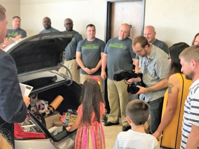 Soldiers from the first graduating cohort of Caliber Collision's Changing Lanes program at Ft. Hood repaired and presented a Recycled Rides vehicle to U.S. Army veterans Patrick and Antoinette Dombroski and their children.