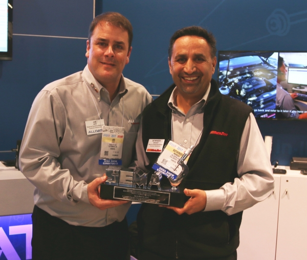 ALLDATA captured first place in the Collision Repair and Refinish category in the 2017 SEMA New Products Showcase. From left, Mechanical Field Rep Joe Foti and General Manager Satwinder Mangat proudly display their trophy.
