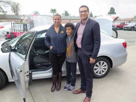 Veteran TeJae Dunnivant and her son received a 2014 VW Jetta from CSAA Insurance. CSAA Insurance Group's Community Affairs Coordinator Victor Cordon stands with the Dunnivants at Mike's Auto Body.