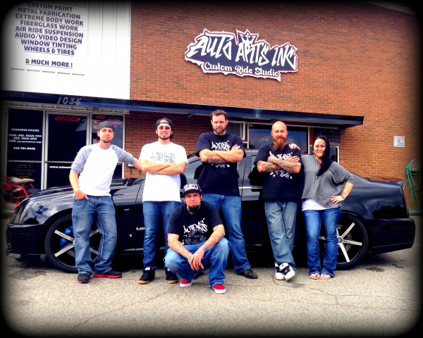 The Auto Arts team from left to right: Zack Matthews, Alfred Anzelon, Shea Jenness, Travis Brown, and owners Mike and Valerie Miles.