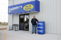 Scott Hill, co-owner of Levander's Body Shop and Service Center, stands in front of the expansion that houses the full-service shop across the street from the original body shop at 2306 E. Philip Ave. in North Platte.