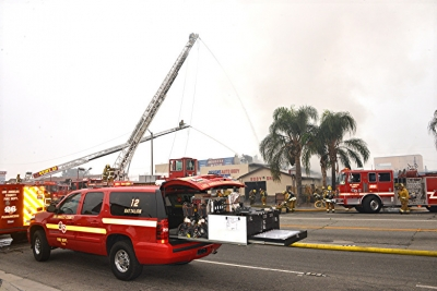 Los Angeles County firefighters battle a blaze in which arson was suspected at an auto body shop along Valley Boulevard in Bassett on Sunday, November 26, 2017.