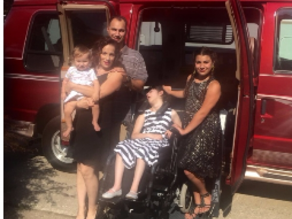 A family whose daughter suffers from Dandy Walker Syndrome received a refurbished van from Bi-County Auto.