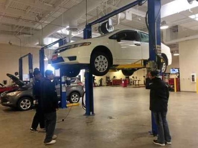 A group of automotive students study safety inspections at Vallejo's new, state-of-the-art Solano Community College Automotive Technology facility.