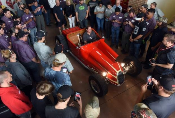 Daniel Vehse starts up the engine to the hot rod as a crowd gathers around to see at the Aims Automotive and Technology Center, 1120 Southgate Drive, in Windsor, CO. Vehse, co-creator of the hot rod, designed it with the Jerry Magnuson before Magnuson died. The car was Magnuson's final project.