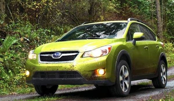 The 2014 Subaru XV Crosstrek Hybrid hatchback (here in Plasma Green Pearl) in its natural habitat.