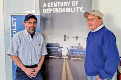 Troutwine's new body shop manager, Bobby Vale, left, is filling the shoes of Russ Julien, right. Julien retired Feb. 2 after 48 years of service.