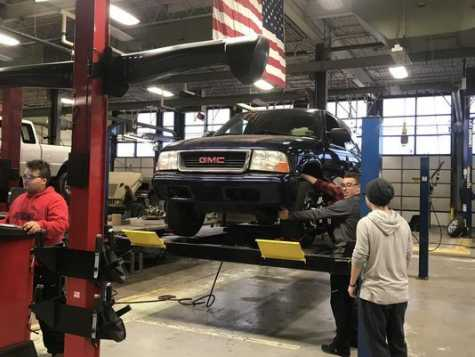 Students in Canton High School's CTE automotive technology program work with the alignment machine that was purchased with funds through a grant from the Margaret Dunning Foundation.
