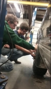 Cordell Scarborough, 17, a West Burlington High School junior, and Brock Anderson, 17, an Illini West High School junior, tighten lugnuts on the front driver's side tire of Anderson's 1998 Chevy S10 in the Automotive Technology lab at Southeastern Community College in West Burlington.