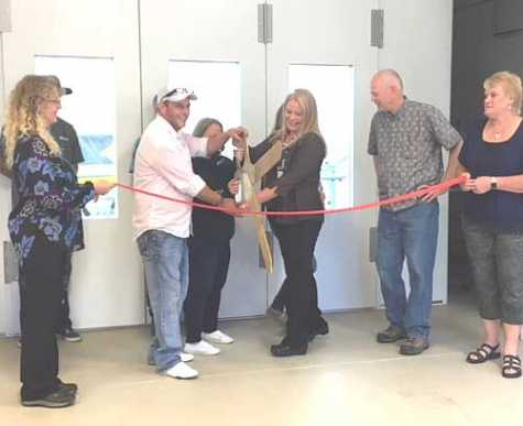North Idaho Collision Repair Center Owner Shane Florea and Bonners Ferry Chamber of Commerce President Jennifer VanEtten officially opened the new shop with a ribbon cutting June 22.