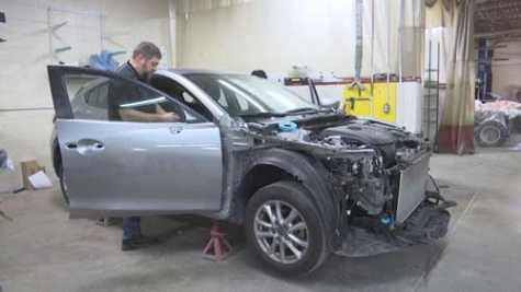 A car gets worked on at Williams Auto Body in Ashwaubenon, WI, after hitting a deer.