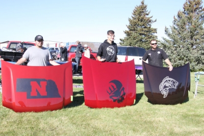Savion Smith, left, of Ogallala, won the North Platte Community College Auto Body Program automobile hoods contest on Oct. 19. Second place went to Chance Boersen with the Mopar hood and third place to Charles Martin with the largemouth bass design.