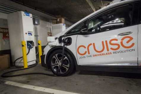 A General Motors Co. Cruise autonomous test vehicle is parked at a new charging station in San Francisco, CA, on Monday, July 2, 2018. Cruise has installed 18 fast chargers in a parking facility on San Francisco's Embarcadero, a busy boulevard along the city's eastern shoreline where Uber Technologies Inc and Lyft Inc. have busy drivers.