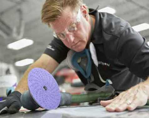 Automotive celebrity Chip Foose demonstrating products from 3M Automotive Aftermarket Division.