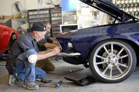 Glynn Frazier and Nick Papanicolas work on a car at Boggs Body in Warrenton, VA.