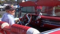John Shuffield sits in his restored Cadillac. (KSBY photo)