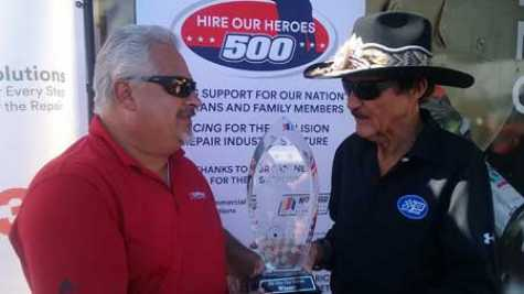 Richard Petty presents the trophy to Gary Boesel.