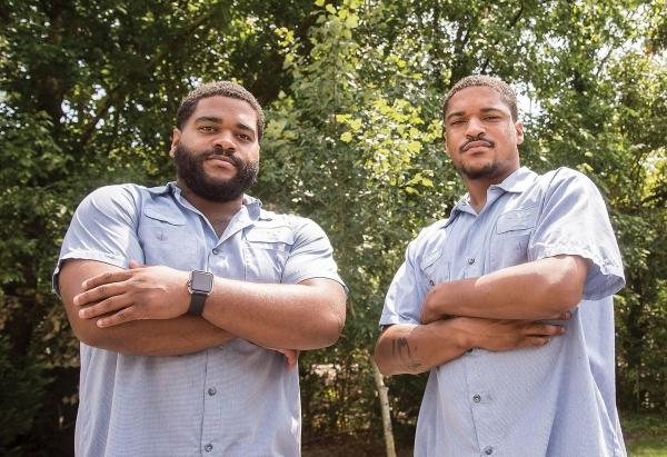 Brothers Keyon (left) and Chattney Harris pose for a portrait on July 25 at J&C's Auto Body and Detail Shop. Photo courtesy of Ryan Revock / Statesville Record & Landmark.