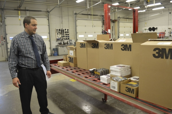 Jeff Tech Vocational-Technical School Administrative Director Barry Fillman looks over a recent donation of 3M products for use in the Automotive Collision Shop.