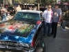 Artist Mickey Harris (left) with Pat Tillman's former teammate Zack Walz and a 1968 Chevy Impala, the Pat Tillman Foundation tribute vehicle.