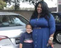 Army Veteran Eboni Strader, with her son Isaiah, received a 2014 Toyota Corolla from Caliber Collision in conjunction with Allstate Insurance as part of NABC's Recycled Rides program last year.