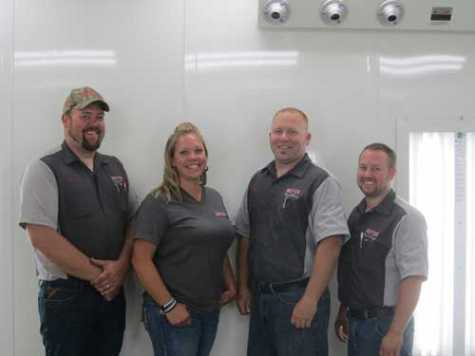 Meyer Body and Paint owners Eric and Andrea Meyer with technicians Clifford Judkins and Brian Bries.