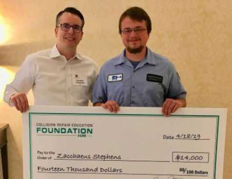 Zac Stephens (right) received a $14,000 scholarship from Brandon Eckenrode, director of development for the Collision Repair Education Foundation. The scholarship, that eliminates Stephens' student debt, was made possible through the fundraising efforts of the Nashville I-CAR committee.