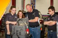 Cañon City High School students receive instruction from Automotive Technology instructor John Duston during the auto course at CCHS.