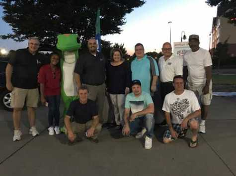 From left to right: All the participants involved in the Recycled Rides event gather together for a photo after the cars had been revealed. Ken Lalia (GEICO), Esther Rock (EOC Suffolk County), Gecko, Christopher Russel (Veteran Recipient), Kevin Costigan (GEICO), Kathy Brenton (GEICO), Ed Gubelman (GEICO), Anthony Pascuita (The Collision Centers) Joe Amodei (The Collision Centers), Mickey Cerbelli (The Collision Centers), and Mark Davis (Veteran Recipient).