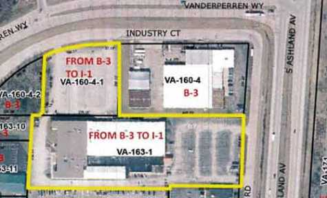 The expansion of Broadway Automotive with the purchase of two parcels includes rezoning them to allow automotive body repair and painting.