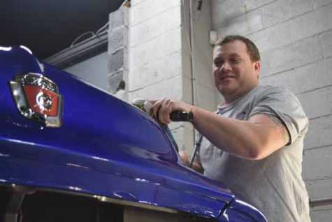 Eric Lafata, co-owner of Lafata Auto Body in Roseville, works on a 1954 Ford F-100, one of nine vehicles Lafata's team will show March 2--4 at the Detroit Autorama at Cobo Center.