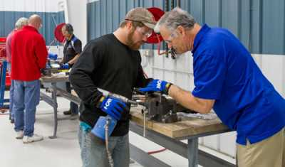 I-CAR instructors help educate tomorrow's collision repair technicians with hands-on experience.
