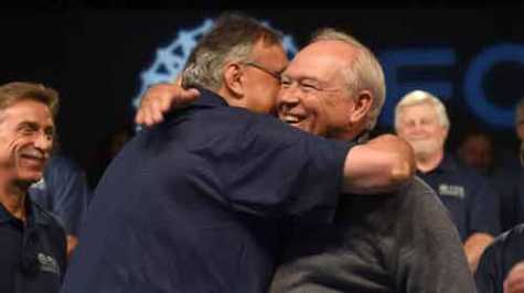 Fiat Chrysler CEO Sergio Marchionne, left, and UAW President Dennis Williams embraced at the start of contract talks in 2015. GM charges Marchionne orchestrated a bribery conspiracy to corrupt three rounds of bargaining with the UAW in an effort to harm and take over Detroit's biggest automaker.