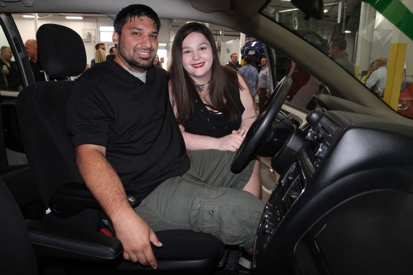 Justin Greigo and his fiancee, Chelsea Decker, check out their new ride, a 2014 Plymouth Dodge minivan.