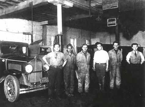 Joe Gurreri shared this photo of some of the mechanics at O.K. Service Garage, in the former AAA building at 116 E. Market St. The service area was on the second floor, and a car elevator took cars up for service. Joe's uncle Nick Gurreri is at left; next to him is another of Joe's uncles and Nick's brother, Bernie. The one in the white shirt is Joe's namesake, his uncle Joe, another Gurreri brother.