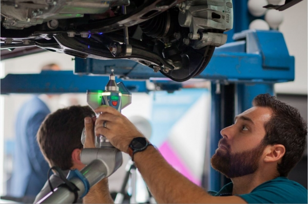 A technician takes laser measurements of a vehicle at the Mitchell Technical Research Center in San Diego, CA.