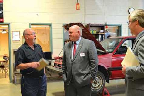 "Auto collision repair and auto technology instructor Harry Wolfe talks with U.S. Rep. Glenn ""GT"" Thompson as CTC Director Ken Kryder looks on."