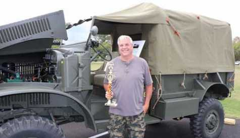 Retired TCHS Brandywine Automotive Collision Instructor, Mark Serfass, returns to the TCHS Car Show and receives the first place military vehicle trophy for his 1943 International MQ4.