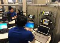 Miguel Mora Botello (right) and Joe Ortiz (left) perform remote scans using Mercedes Benz Xentry scan tools with asTech.