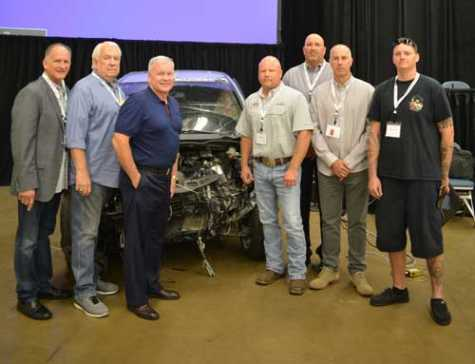 "Todd Tracy revealed the results of his latest crash test during the Texas Auto Body Trade Show. From left to right: Larry Cernosek (Houston Auto Body Association), John Kopriva (Houston Auto Body Association), Todd Tracy, Kevin Jordan (Burl's Collision Center), Burl Richards (Auto Body Association of Texas/Burl's Collision Center), Jerry McNee (Ultimate Collision Repair), Donald ""Trip"" Springer (Burl's Collision Center)."