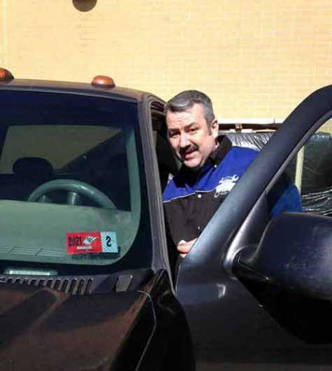 Mingo Central High School automotive instructor Chris Roberson recently gave out his first vehicle inspection sticker after the MCHS CTE Automotive shop was certified as an official West Virginia vehicle inspection station.