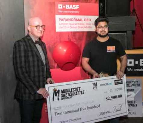 2018 Detroit Sketchbattle winner, Shubham Singh, accepts his $2,500 check from Paul Czornij, Head of Design for BASF in North America, in front of the custom color Paranormal Red. (photo by Trista Dymond)
