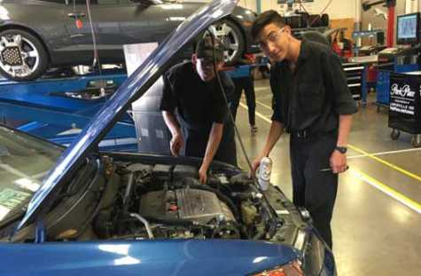 LISD students working on vehicles donated by community members, including a 2004 GMC Yukon XL, 1963 Ford Thunderbird and 2004 Acura TSX.
