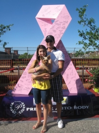 Dave Ludwig and his daughter, Elizabeth, stand next to Ludwig's first sculpture, a 9-foot pink ribbon that he designed with a local radio station to create awareness about breast cancer in New Hampshire.
