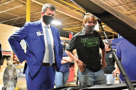 Cullman County Schools Superintendent Shane Barnette, left, and CATA Auto Service Technology student J.P. Johnson, right, take a look under teh hood of the school's new Mercedes-Benz C300.