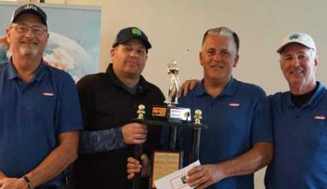 First-place team: John Hinkemeyer, Rich Freil, Mark Simons and Brian Johnson.
